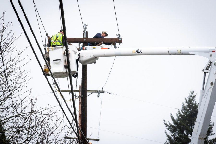 Snohomish County PUD workers repaired damage to the downed power lines that resulted from the car crash.