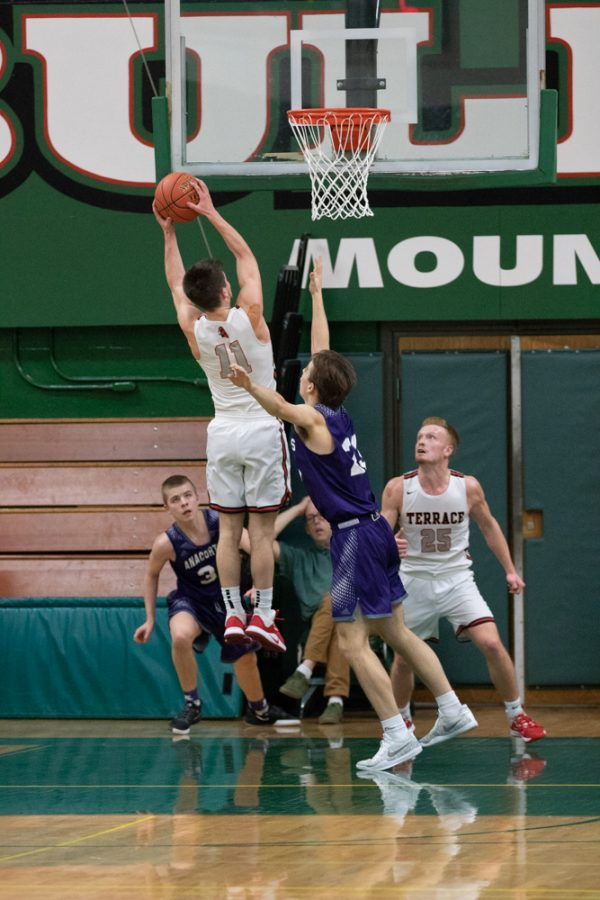 Christianson expels his arms forward in order to grab a missed shot from Anacortes.