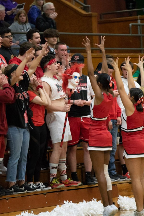 The Rowdy Rooters shout their grades in the Whos the Best? cheer.