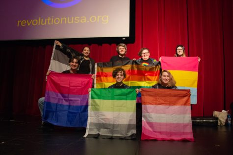 MTHS GSA presenters pose with the pride flags.