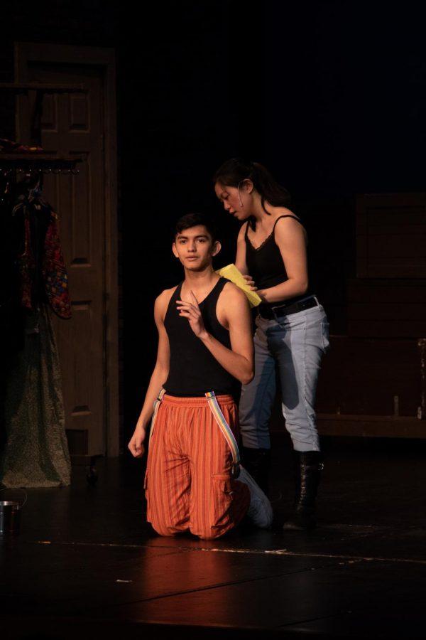 Anabelle Sumera-Decoret, sophomore, who plays as John the Baptist and Judas, baptizes Alberto Paredes, Senior, who plays as Jesus.