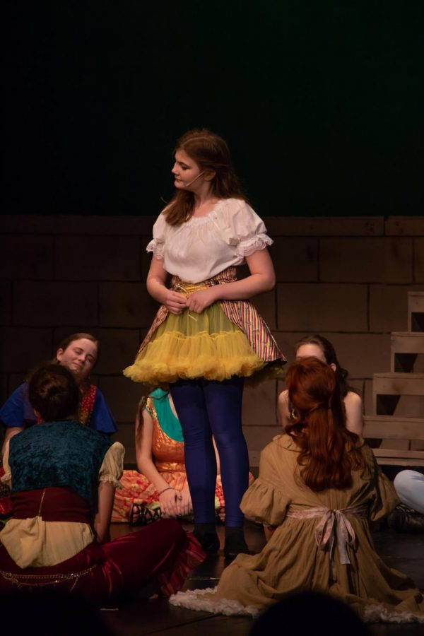 Hanana Fisker- Andersen, sophomore, who plays as herself, looks over at Jesus while performing the song