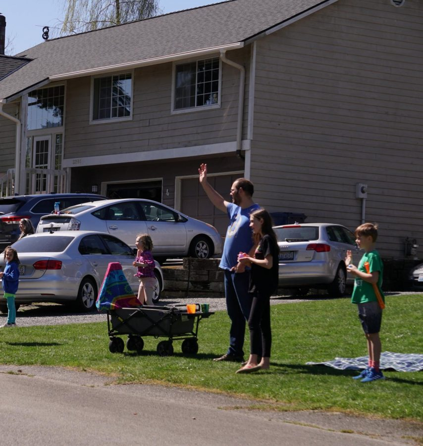 Families gather in their front yards to watch the Easter procession pass by their houses spreading a holiday spirit. The passage of the Easter Bunny was the main attraction of the parade.