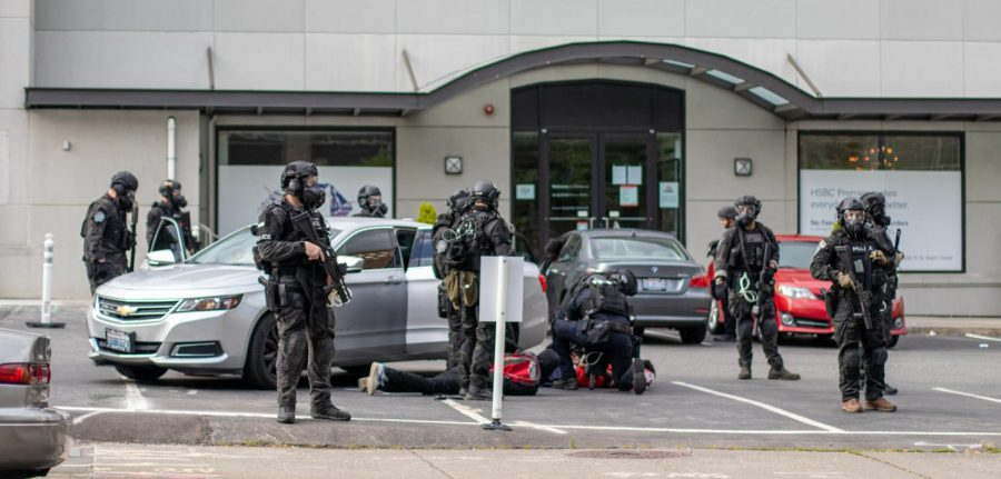 Multiple men are arrested by Bellevue Police across the street from Bellevue Square Mall.