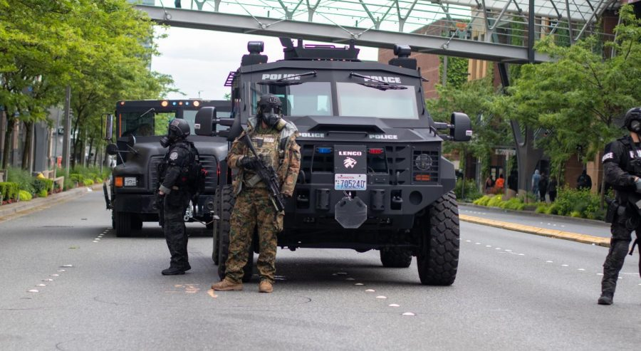 Bellevue Police bring out tactical officers in an armored truck.